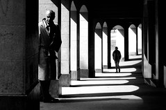 Candid - Château (Phonatics) Tags: candid street urban people black white bnw bw light shadows sun man girl lausanne switzerland nikkor nikon d300 50mm