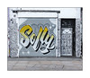 Street Art (Sophy Nails, Travis4Sale), East London, England. (Joseph O'Malley64) Tags: sophynails sofly streetartist streetart urbanart publicart freeart graffiti eastlondon eastend london england uk britain british greatbritain art artist artistry artworkmural muralist shutter rollershutter shop shopfront businesspremises door doorway woodenpanelleddoor blockedfanlight entrance exit render victorianbuilding victorianstructure wiring electricalwiring drainpipes aluminisedtape doodles stickers slaps tarmac pavement accesscovers tonguegroove urban urbanlandscape aerosol cans spray paint fujix x100t accuracyprecision travis4sale
