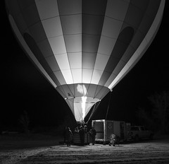 Hot-Air-Balloon Glow In V (JasonCameron) Tags: bluff international balloon festival glowin glow lantern light night fire hot air monochrome black white utah stars