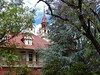 Mystery Mansion Behind Trees (mikecogh) Tags: stmorris mansion mysterious jacaranda trees tower steeple