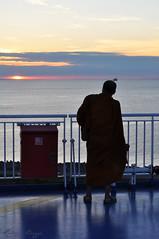 The monk and the sunset (DameBoudicca) Tags: sweden sverige schweden suecia suède svezia スウェーデン malmö マルメ öresund øresund エーレスンド strait sund meerenge estrecho détroit stretto 海峡 sunset solnedgång sonnenuntergang ocaso coucherdesoleil tramonto 日没 ferry photographer monk buddhistmonk munk buddhistmunk fotograf bhikkhu monjebudista monje bhikshu monacobuddhista monaco 比丘