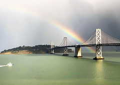 rainbow across the bay bridge (Aqua and Coral Imagery) Tags: rain sun rainbow sf sanfrancisco city nature bay baybridge colors colorful glow bright beauty