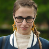 Smile with Style (Stuart Mac) Tags: woman smile eyes pleat glasses stars earrings look spectacles face d700 pose