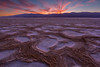 Glow on Salt Flats under Sky on Fire - 8408 (J & W Photography) Tags: 2017 americansouthwest california cottonballbasin deathvalley deathvalleynationalpark december jwphotography badland buringsky cloud desert dusk glow landscape mountains nature redsky saltflat saltpolygons southwest sunset valleyandridge wastserra winter