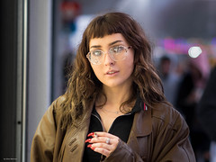 Isabelle (Silver Machine) Tags: southampton hampshire streetphotography street streetportrait girl glasses leatherjacket nails smoking cigarette outdoor bokeh brunette shopwindow fujifilm fujifilmxt10 canonfd85mmf18