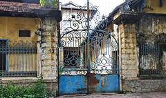 French-Colonial Building (VIETNAM) (ID Hearn Mackinnon) Tags: wrought iron cast gate gateway metal hanoi ha noi 2016 vietnam vietnamese viet south east asia asian north french colonial era architecture architectural historic historical history european building old fading significant culture design