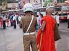 Sins of the Night (solas53) Tags: look saffron men street people sri lanka buddhist monk police orange looking kandy