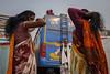 Hair tie (SaumalyaGhosh.com) Tags: hair tie people color india street streetphotography kolkata women watch