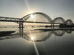 beams (PawL23) Tags: sagaing reflection silhouette newavabridge myanmar burma ayeyarwady irrawaddy river bridge sun sunset riverpool ships boats oldava inwabridge