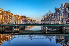 Leiden, the Netherlands (thijs.coppus) Tags: mirror spiegel reflectie houses grachtenpanden huizen hemel lucht sky blue winter ship boot boat wasser water canal singel gracht fahrrad fiets bike stadt stad city dutch zuidholland holland niederlande nederland netherlands leiden