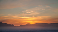 Raven light (Clare Kines Photography) Tags: arctic timelapse nunavut corvuscorax sunrise arcticbay raven north bird sun pair canada icefog corvid adamssound syrpgeniemini