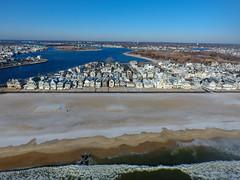 A snow-covered Manasquan Beach and the Atlantic Ocean, captured by a DJI Phantom 4 drone. (apardavila) Tags: atlanticocean djiphantom4 fb jerseyshore manasquan manasquanbeach manasquaninlet manasquanriver aerial beach beachfronthomes drone morning rocks sky snow waves