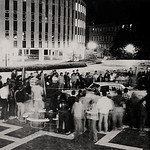 Students destroy a car during homecoming activities on the Brickyard in the '70s.