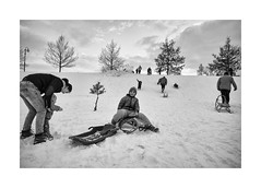 Sledging (Jan Dobrovsky) Tags: countryside bicycle krásnálípa winter leicam sledging people reallife toboggan northernbohemia counrtylife village gypsies document biogon 21mm