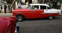Red and White BelAir (Anthony Mark Images) Tags: people cabbie driver road yellowbuilding restaurant irongate taxi cab cabdriver redcars classiccars americancars 1950s belair redandwhite havana cuba carribean streetphotography red