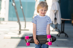 Adorable kid outdoors. Cute pretty child smiling at camera. Casual boy on summer time skating on a skateboard. Holding skateboard like a present (elenachukhil) Tags: boy child kid skateboard skate outdoors emotional pretty little cute son havingfun outside strippedshirt sunglasses summer spring happy happiness childhood adorable very blond longhair human people spendingtime leisure joy male jeans hobby expression fun youth sport roller smile enjoy ride person white skater cheerful caucasian active