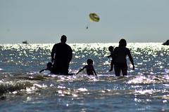 ...family enjoyment... (carbumba) Tags: silhouette shadow water glittery shine sparkle family people nikon