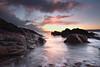 SunriseCushendunDec2017 (CharlesM-2) Tags: northernireland nikon northcoast ireland irishsea longexposure coast causewaycoast sea seaofmoyle water rocks sunrise sun sunlight clouds pebbles charlesm charlesm2 shadowpm2 d7100 tokina 1116mm