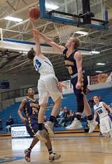 Something that flies (Ogedn) Tags: basket ball hoops indoor high school