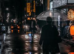 A street scene in night Tokyo (Dmitry_Pimenov) Tags: cinematic tokyo tokyostreets street dark night shadow japan rain rainy urban cityscape cityview people light lights umbrella asia olympus olympusru olympusomdem5 omd5 dmitrypimenov dipimenov дмитрийпименов олимпус токио япония ночь город улица дождь