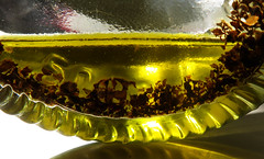 Olive oil with basil (Alfredo Liverani) Tags: macromondays macro mondays closeup mm hmm italy pov dof inabottle canong5x canon g5x pointandshoot point shoot ps flickrdigital flickr digital camera cameras cibo food lebensmittel aliments alimenti alimento kitchen cucina inthekitchen incucina