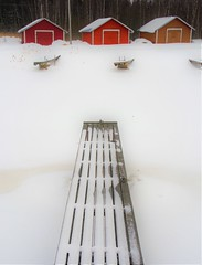 Podium (STTH64) Tags: wooden pier barn boat snow ice sea seaside winter red white