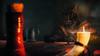 030 Drowning a Guilt (vitvalecka Skyrim) Tags: elderscrolls specialedition skyrim game inn candle wine dark light pub tavern khajiit cat fur candlelit bottle screenshot ingame