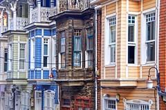 Old Colorful Houses (yonca60) Tags: arnavutkoy houses wood colorfulhouses istanbul turkey street streetlamps windows rhytm