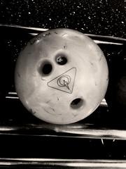 Boo (revalec) Tags: bowling ball snapshot fun funny humour blackandwhite cameraphone surprise shock