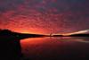 Illinois Bayou Sunset (zormsk) Tags: sunset illinoisbayou water ano clouds coolingtower canon red sky reflection winter