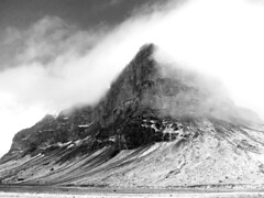 From the mist... (Craperture91) Tags: iceland black white monochrome canon mist clouds rock travel
