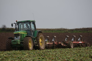John Deere 7710 Tractor with a Gregoire Besson 6 Furrow Plough