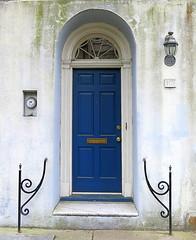 Blue door, Rainbow Row, 107 East Bay (c.1792), Charleston, SC (Spencer Means) Tags: dwwg charleston sc rainbowrow architecture building house door doorway arch arched southcarolina blue railing iron lamp lantern eastbay street