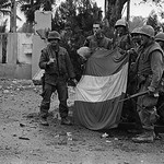 The battle of Hue 1968 - U.S. Soldiers Dismantling Viet Cong Flag thumbnail