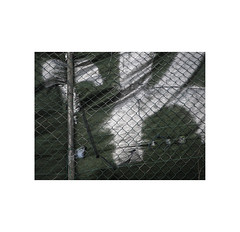 Grafitti...   ( Pamplona ) (José Luis Cosme Giral) Tags: graffiti minimalism mesh fence decay paint abstract textures olympus pamplona navarra