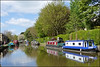 Springtime along Skipton canal. (Country Girl 76) Tags: skipton north yorkshire leeds liverpool canal narrow boats trees water reflections people blossom swing bridge colours building sky clouds