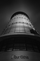 Formation (blondmao) Tags: fineart glass building bnw bourgognefranchecompté facade windows bourgogne longexposure tourelithis côted'or dark burgundy architecture france tower blackandwhite dijon bw