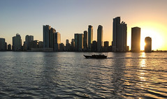 Sunset in Sharjah (Irina.yaNeya) Tags: buhairacorniche sharjah uae emirates city sunset architecture sky sea ocean water boat buildings waves reflection light cityscape skyline skyscraper iphone sunlight sun eau cielo ciudad puestadelsol arquitectura mar agua barco edificio olas reflejo luz sol الامارات الشارقة غروب مدينة فنمعماري بناء سماء بحر ماء قارب أمواج ضوء برج الشمس шарджа оаэ эмираты закат архитектура небо море вода лодка волны отражение свет небоскреб солнце город