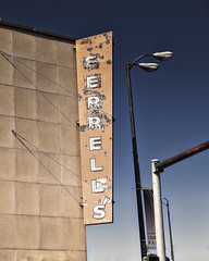 Feral Neon (Noland Voide) Tags: purple idaho neon sign department store old decaying small city blue crusty
