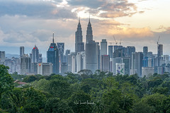 Kuala Lumpur City Skyline at Sunset (Nur Ismail Photography) Tags: city malaysia architecture skyline landmark sunset cityscape twin asia klcc urban building tower famous modern kuala lumpur skyscraper sky park place scene business landscape dusk downtown night travel kl evening twilight tall view office district financial scenery malaysian center town highway shopping reflection scenic panorama centre capital blue corporate metropolitan