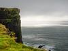 Reaching Iceland's end (einsenfei) Tags: em1 iceland island mft cliffs sea sun weather grass coast landscape sky rock