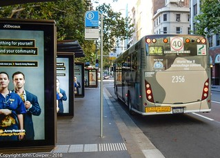 Sydney Buses - Volvo ST 2356 as if heeding the poster on the left arrives at Wynyard in camouflage