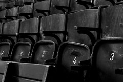 Old chairs (Daniel Nebreda Lucea) Tags: chair chairs silla sillas numbers números many muchos muchas pattern patron texture textura wood madera old viejas antiguas theatre teatro black white blano negro monochrome monocromatico canon 50mm 60d prague europe europa composition composicion light luz lights luces sombras shadows seats sillones butacas empty vacio atmosphere atmosfera cinema cine abandoned abandonado abanadonadas number numero city ciudad urban urbano details detalles