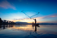 Silhouette of fishermen using nets to catch fish at the lake in the morning (Patrick Foto ;)) Tags: asia asian balance bangkok blue boat burma entrapment environment farmer fish fisherman fishing food job kayak lake laos lifestyle man mirror myanmar nature net paddle peaceful poor poverty province reflect reflection ripple river sky sunlight sunrise sunset thailand tourism tradition traditional tranquil travel tropical water weed tambonbangphra changwatchonburi th