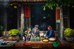Vietnamese family preparing to make Chung Cake, the Vietnamese lunar new year Tet food outdoor (:: Focus Studio ::) Tags: steam meat bean long hung ancestor handmade boil wrap sweet pork split cultural chinese food famous holiday background decoration glutinous fresh green sticky bamboo traditional square chung spring tet leaf vietnamese strings emperor king cake node giang gratitude rice vietnam legend year lunar new flexible shape banh gourmet