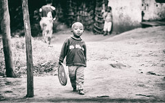 What we can do without. (icarium82) Tags: canoneos450d portrait child travel analogefex people bw tanzania street tamron18200mmf356 africa blackandwhite bnw face menschen reise schwarzweiss strasse tangaregion tansania tz lushoto dust village native
