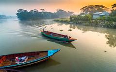 DSC_5362 (Rinathq) Tags: beautiful bangladesh sunset warm winter winter17 landscape boats river colors skies nikon iamnikon d7200 tokina 1116mm wideangle lightroom scenery bangladeshi photography