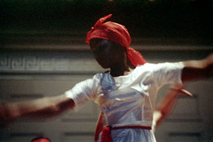 55-591 (ndpa / s. lundeen, archivist) Tags: nick dewolf nickdewolf photographbynickdewolf 1974 1970s color reel55 55 35mm film boston mass massachusetts symphonyhall stage performance catellitrinidadallstars trindadian ambakaila trinidadcarnivalballetandsteelband trinidad carnival ballet steelband dance dancing dancer dancers costume costumes costumed traditional performer performers show caribbean sash redsash woman youngwoman whitedress headwrap