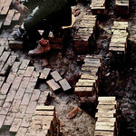 Facilties worker spaces out bricks during a project in the 1980s.