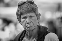 Not a happy camper! (Frank Fullard) Tags: frankfullard fullard candid street portrait unhappy displeased disgruntled lip monochrome black white blackandblancnoirfrancefrenchcolluirebasquemediterraneanshadeseyeeyecontactlookingohouchdirty look collioure